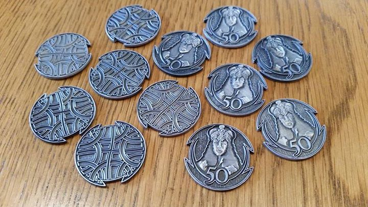 Twelve silver coins, half heads up, half tails up